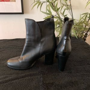 Black heeled leather boots